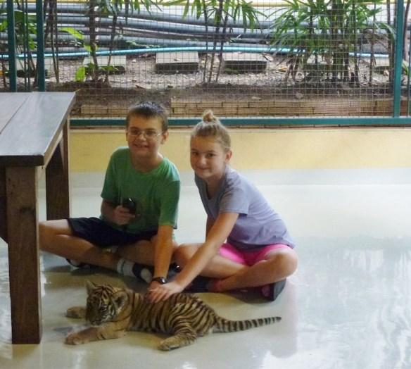 Lars and Anya petting a tiger