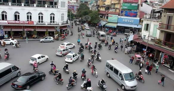 Hanoi Vietnam Crazy traffic.  It can be a bit overwhelming when crossing the street in Vietnam for the first time.  We learned how to cross the street in Vietnam like the locals. It is a great feeling to accomplish such a task and we share our tips with you and a video too! Read more on WagonersAbroad.com