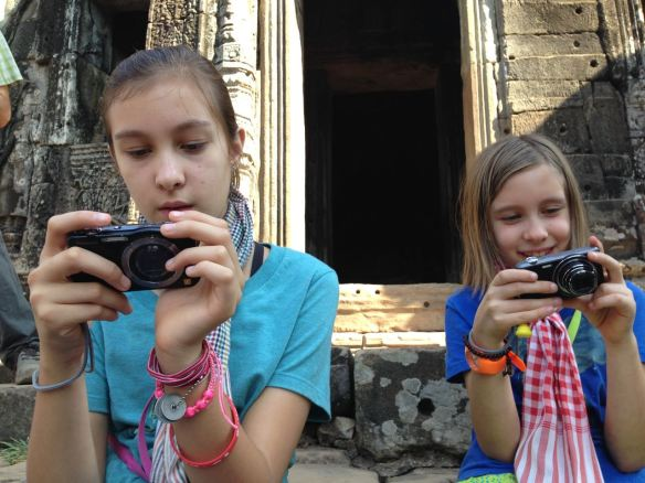 Frankie and Jackie checking out their photos at Bayon