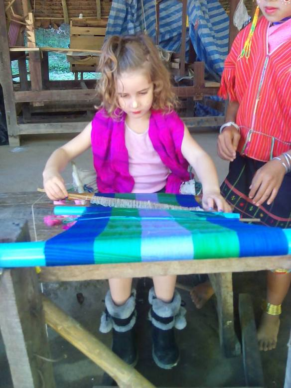 Girl weaving with thailand hill tribe