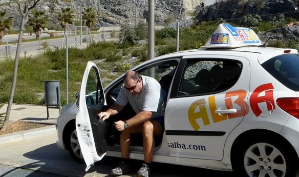Spanish Drivers License Alan Getting out of small car