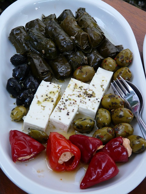 Dolmades - A great vegetarian appetizer made from tender vine leaves wrapped into little rolls and stuffed with rice and fresh herbs, with a touch of lemon. Sometimes meat is also included in the stuffing.