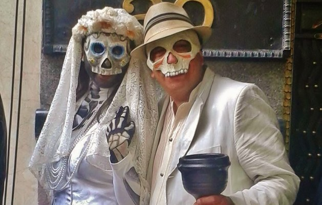 mexican couple celebrating dia de los muertos: day of the deads