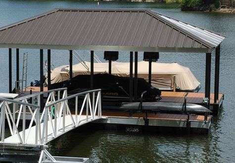 kayak rack on floating dock from wahoo aluminum docks with aluminum gangway