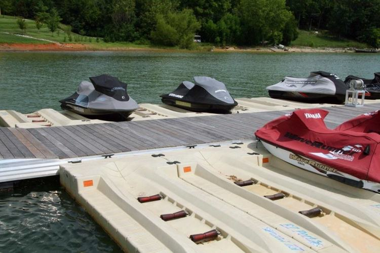 wahoo aluminum docks commercial community dock and marinas with jet ski docking - gable roofs with wood gangway