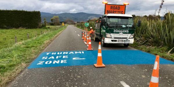 Tsunami Safe Zone road markings appear.