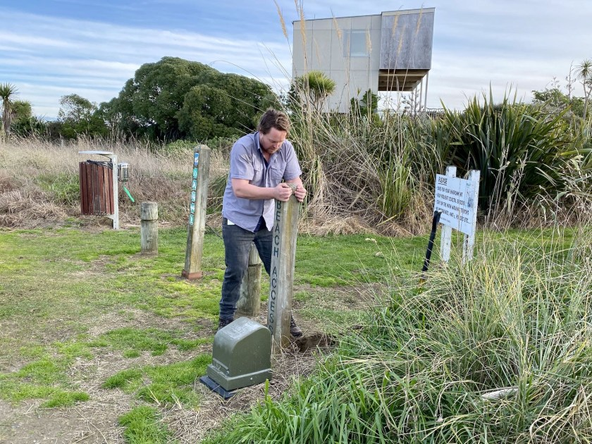 Ben Wood removes the old beach access post at the south track.