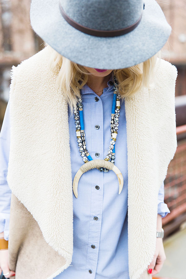Sherpa vest and statement necklace
