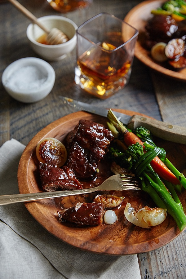 Bourbon honey braised pork shoulder recipe via Waiting on Martha