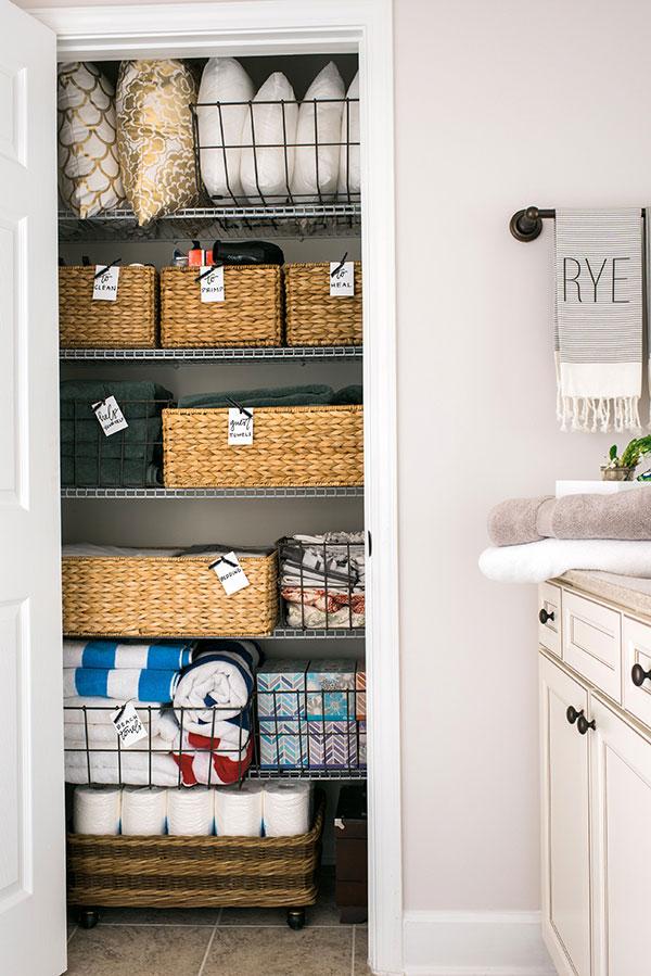 Linen closet organization tricks via Waiting on Martha