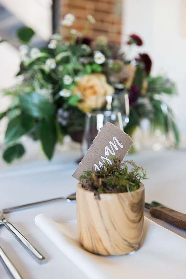 Wooden planter with moss and name tag for rustic wedding inspiration