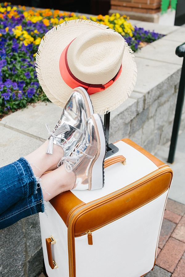 Straw hat, silver Loeffler Randall shoes and white and leather luggage