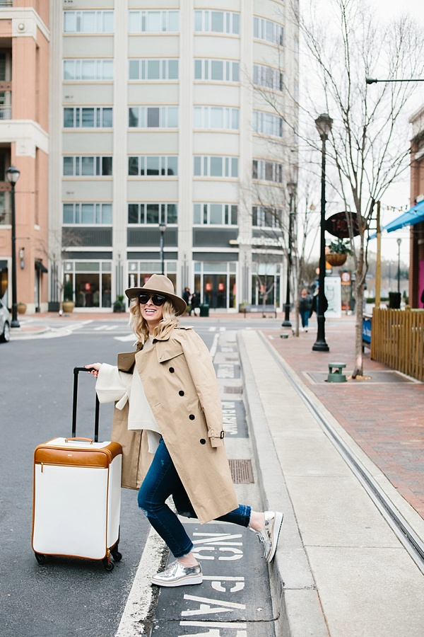 White luggage and trench coat when traveling, waitingonmartha.com