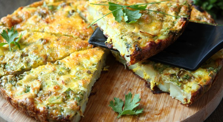 Italian Frittata with slices of fresh greens, food