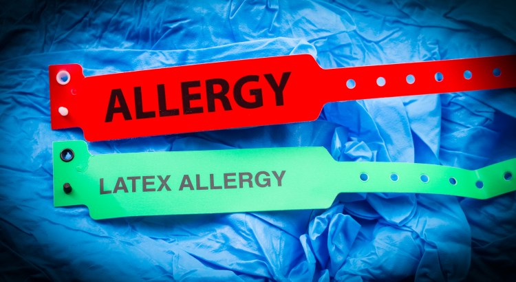 Allergy and latex allergy bracelets over top blue protective gloves