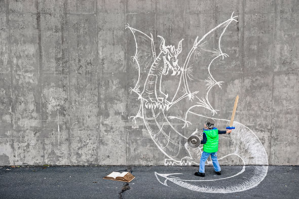 boy-reading-dragon-acting-GettyImages-521698289
