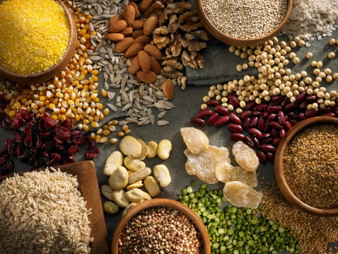 A display of various gluten free and all natural food, including legumes, nuts, rice and more.