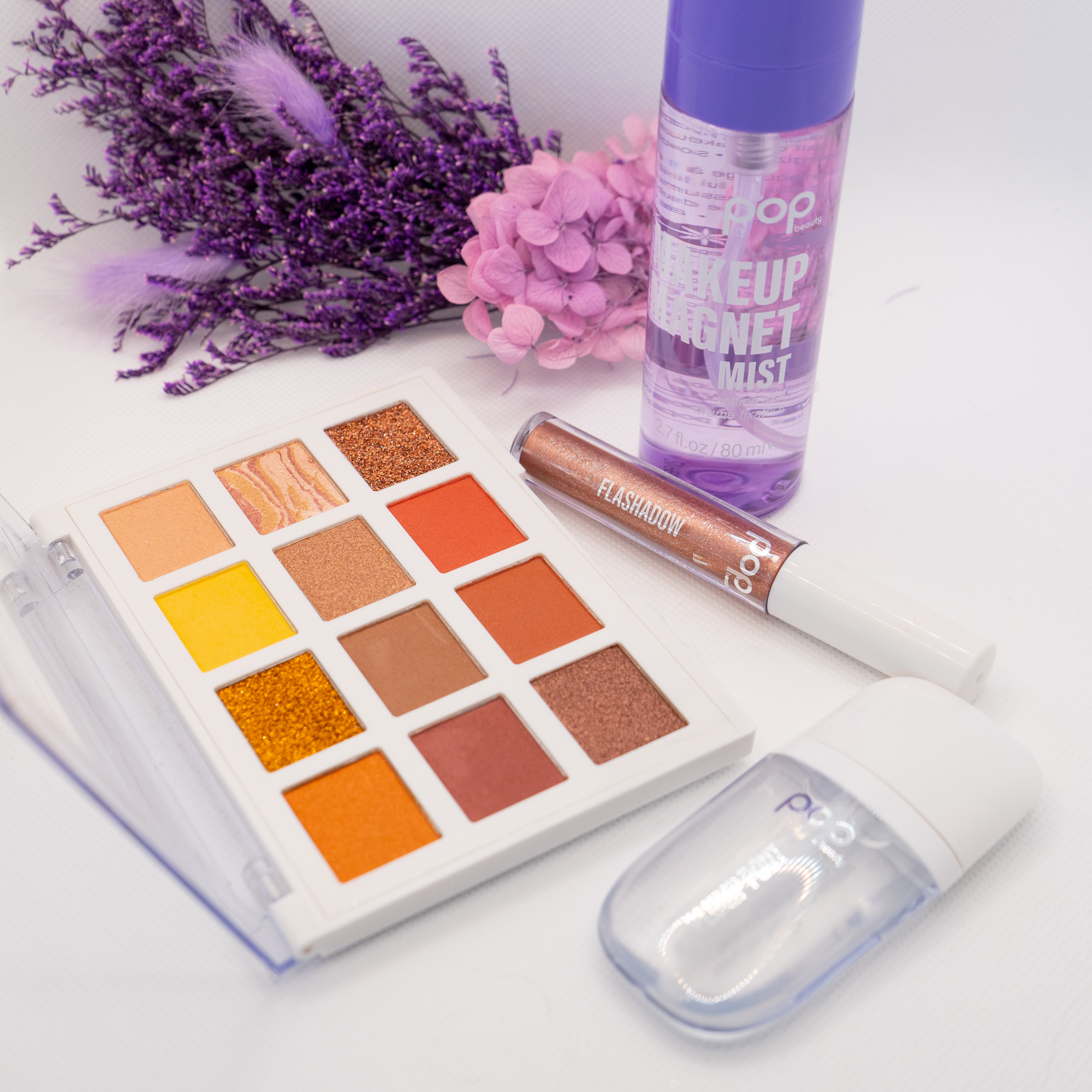 pop beauty eyeshadow palette, liquid shadow, setting spray and clear plumping gloss