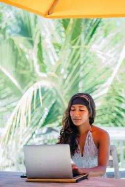woman-using-silver-laptop-2278030