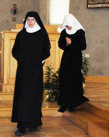 Sr Maria Gertrude followed by Sr Anna just during the clothing ceremony