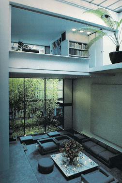 Image shot from the second floor loft looking north toward the bamboo garden showing the double height living room and the third floor guest bedroom at top. From the New York Times article by Paul Goldberg - Halston's Hideway published July 24, 1977