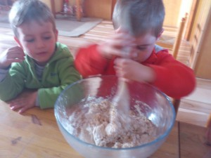 Children willingly participate in the work of kneading the bread.