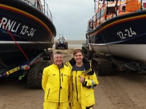 Rhyl lifeboat crew member and his dad feature in lifesaving charity's Christmas