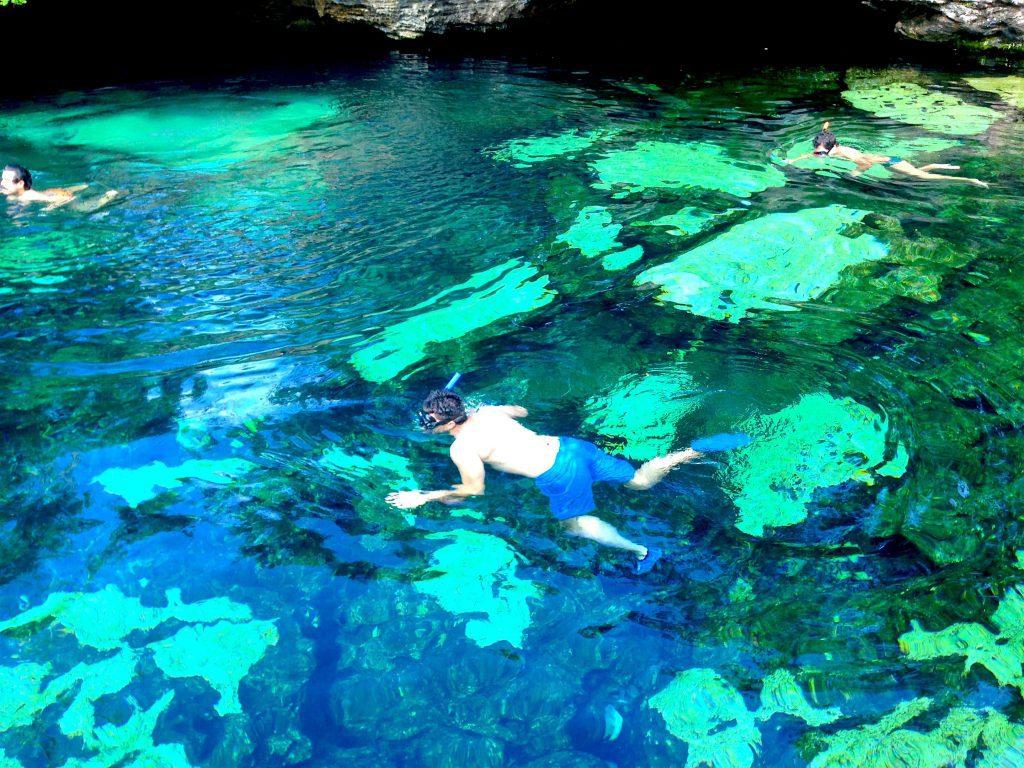 Snorkeler swimming in cent Azul