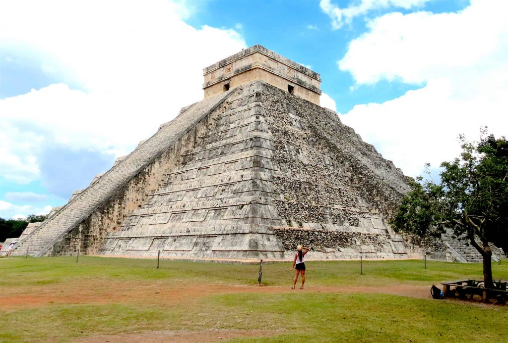 Standing in front of chichen its main pyramid