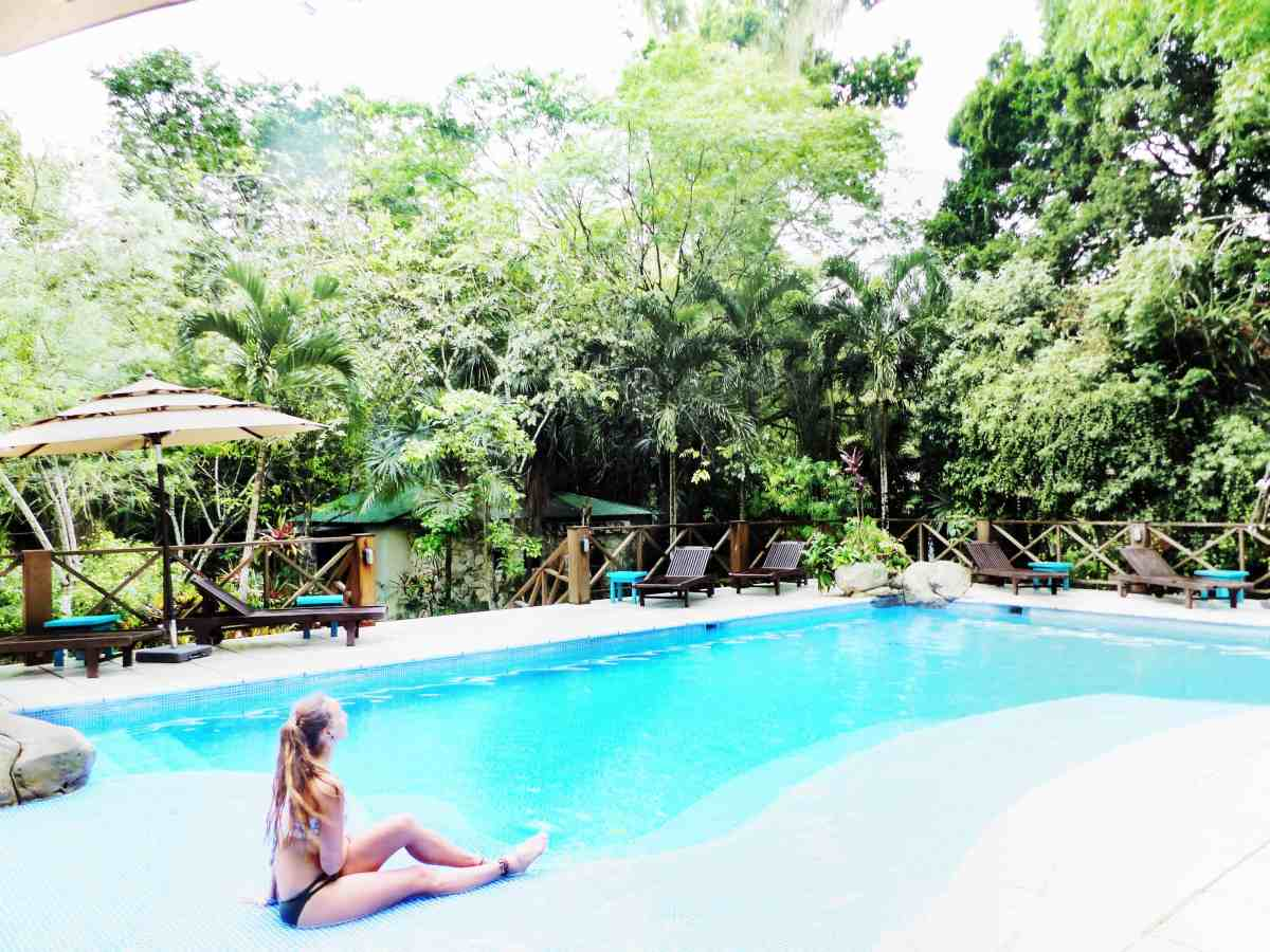 sitting at the pool at the jungle lodge hotel tikal