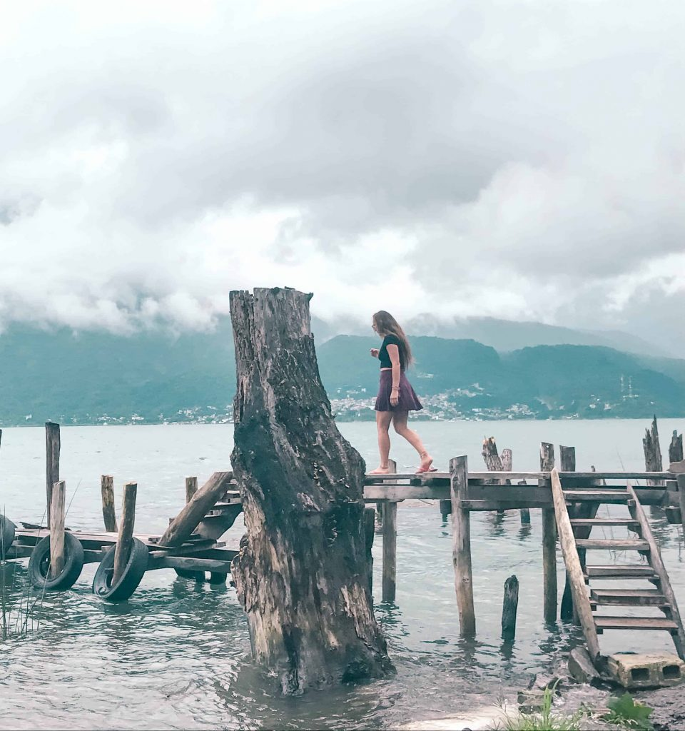 Walking down the crooked docks of lake atitlan