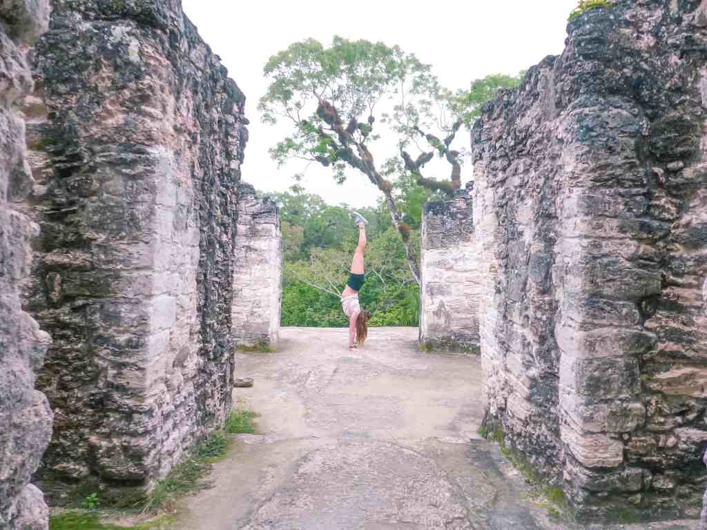 handstand on tikal ruins