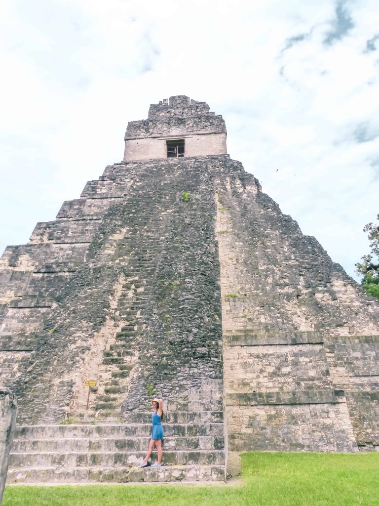 standing on the main pyramid of tikal ruins