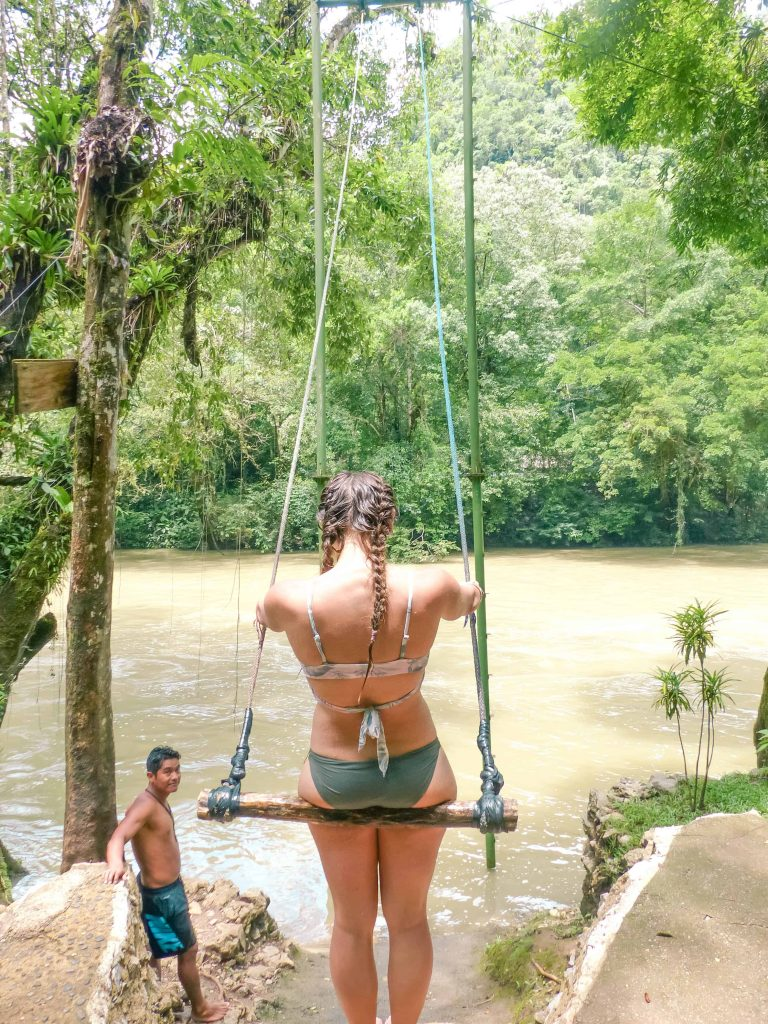 swimming into the river at semuc champey tour
