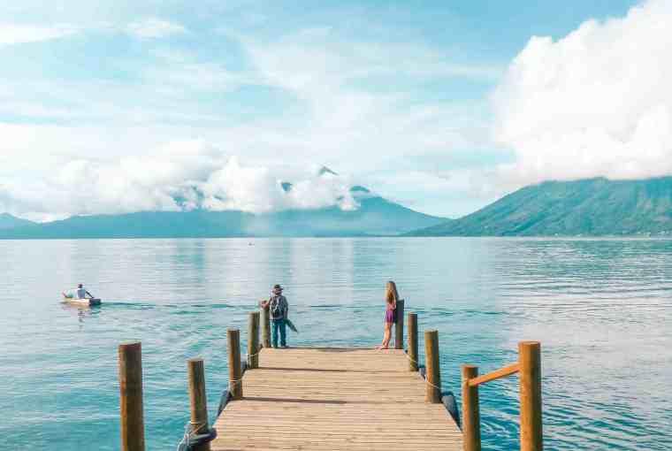 sitting on the dock of san marcos la laguna at lake atitlan