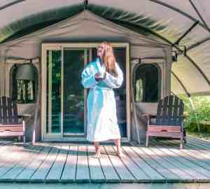 standing in front of glamping tent