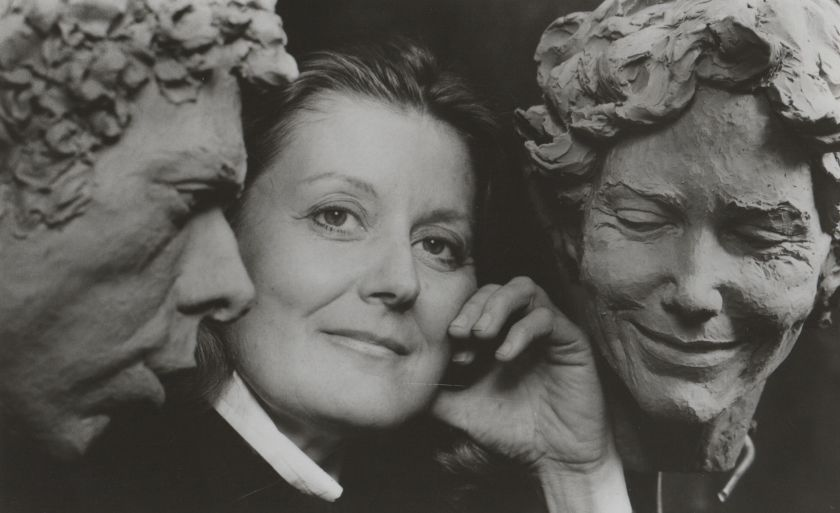 Marion Young flanked by her clay models of Robert Barnett and Kate Sullivan.