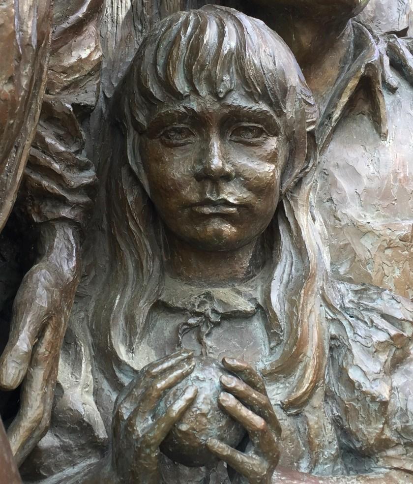 """Virginia Kooiman, """"the child,"""" in Street scene sculpture"""