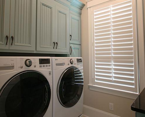 laundry room,painted cabinets,bead board