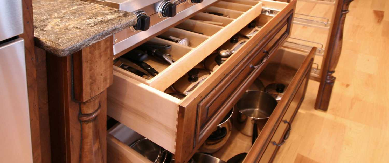 storage ideas,utensil storage,pull out drawers,decorative post,spice rack