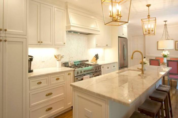 antique brass fixtures, white cabinets
