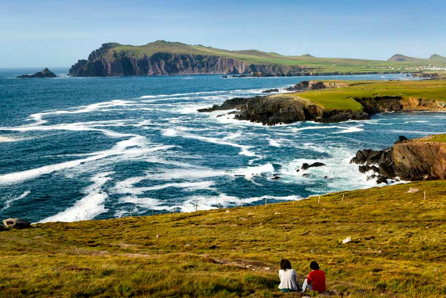 people enjoying the view of the coastline on the dingle way