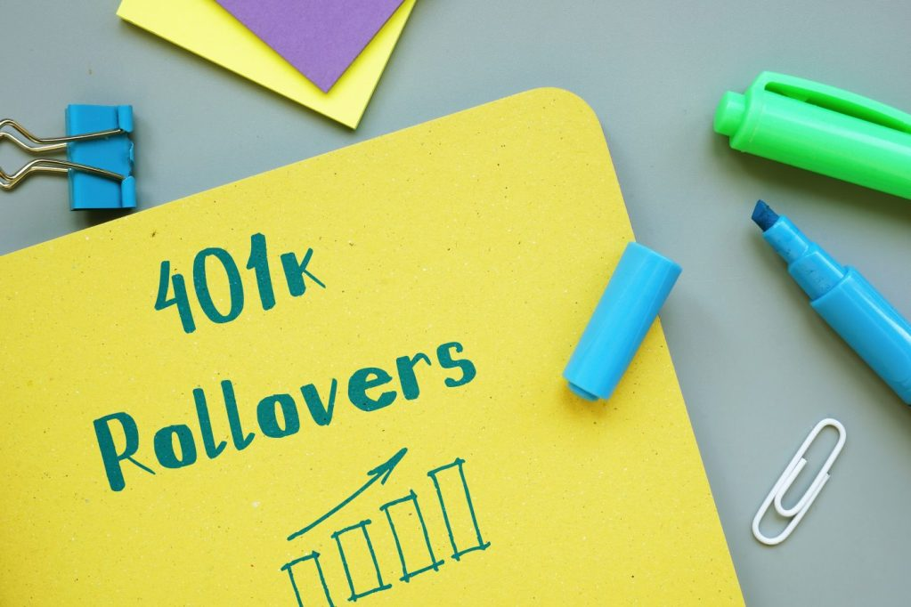 401k rollovers written on the cover of a notebook