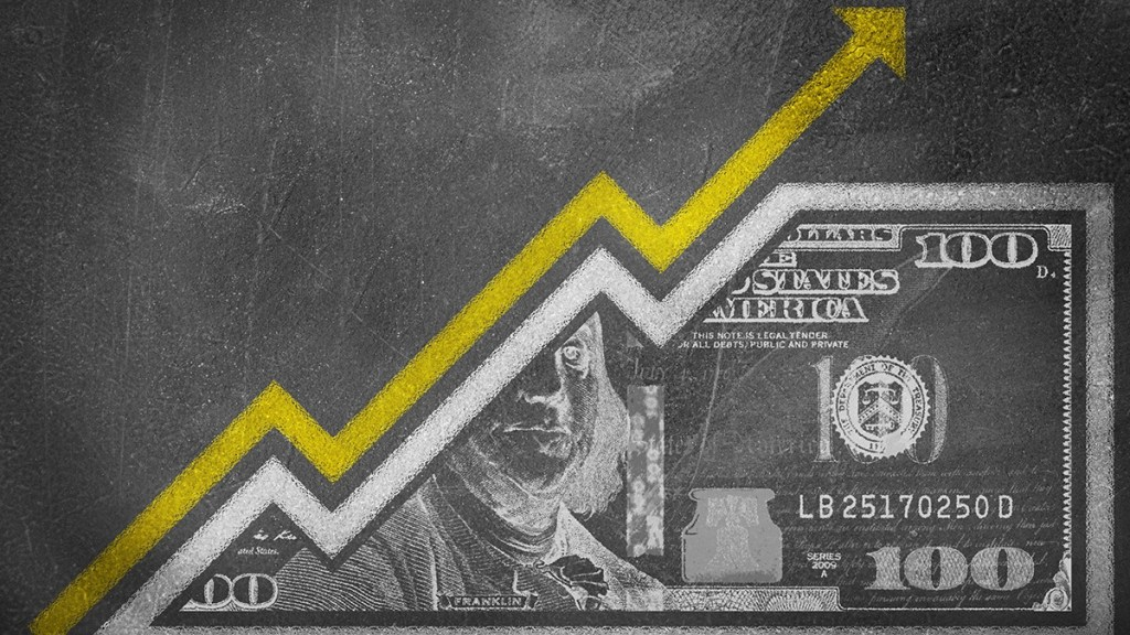 A money bill drawn on a chalk board looking like a growth graph with an upwards pointing arrow symbolizing economic relationships