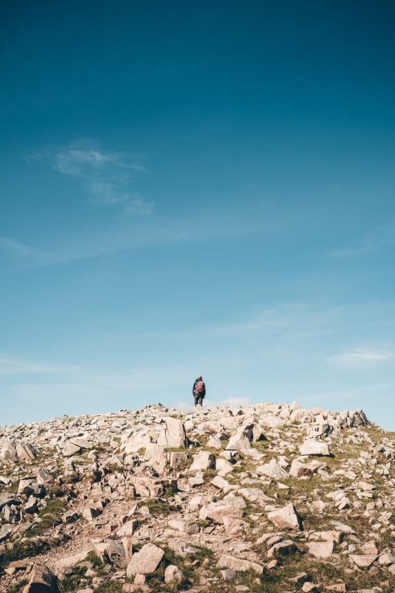 Scotland Glencoe Ali on top off mountain peak