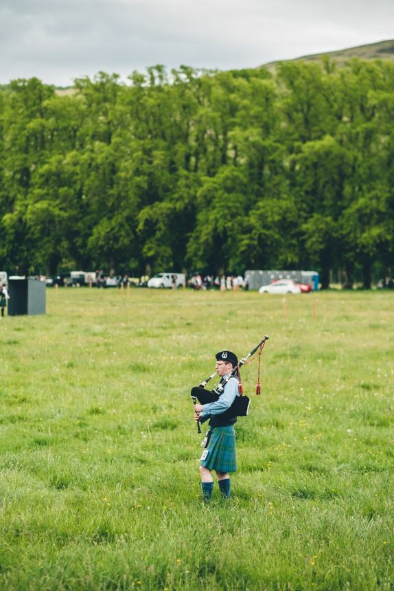Scotland Highland Games Bagpiper in the Field