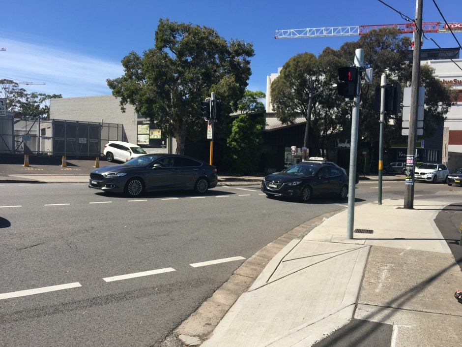 Wyndham Street and O'Riordan Street. I can't cross O'Riordan to get to the Green Square train station, I must cross Wyndham first, and then O'Riordan, waiting for two traffic lights. Cars are not similarly penalized. Is this because cars are more likely to use the train than pedestrians?