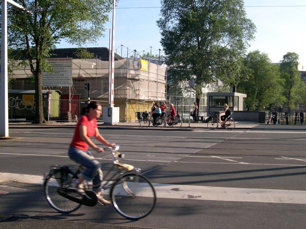 Bicycling in Amsterdam is safer than Sydney, yet there are no helmets in sight. Instead there are separated bikelanes and a better culture, as well as safety-in-neighbors.
