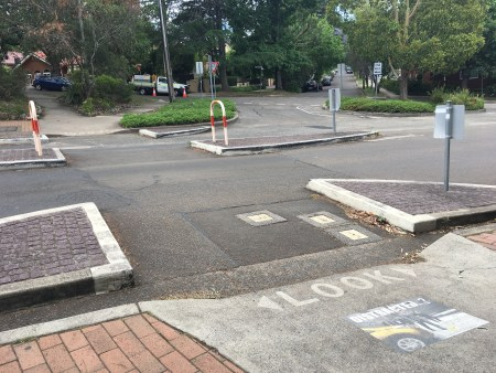 Pedestrian crossing in Artarmon, reminding pedestrians to look at the ground at message asking if they are distracted, rather than the environment around them.