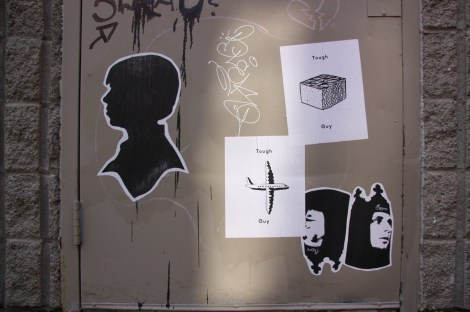 various paste-ups by Rage5 (2 bottom right), unidentified (left), and Tough Guy (centre)
